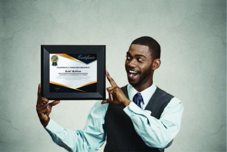 Young man holding a framed certificate.