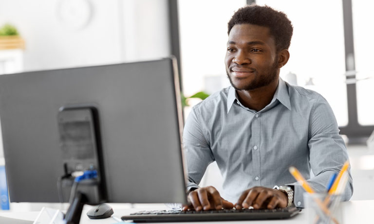 Man typing on computer.
